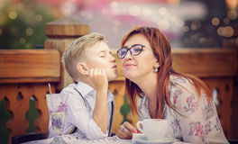 Family and food concept. Mother with son having breakfast together Stock Image