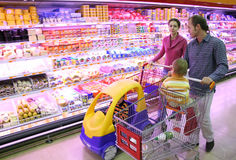 Family in food shop Stock Images
