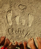 Family footprints in the sand on the beach Stock Images