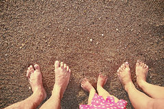 Family footprints in the sand on the seashore Royalty Free Stock Photography