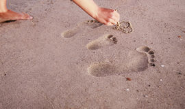 Family footprints in the sand on the seashore Stock Photo