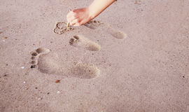 Family footprints in the sand on the seashore Royalty Free Stock Image
