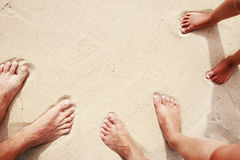 Family footprints in the sand on the seashore Stock Image