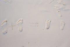 Family footprints on white sand beach Royalty Free Stock Photos