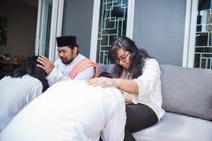 Family forgiving and apologizing each other. eid mubarak. Asian muslim family during eid mubarak celebration. forgiving and apologizing each other stock image