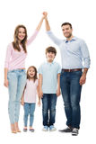 Family forming shape of home Royalty Free Stock Photography