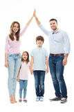 Family forming shape of home. Young family with two children stock images