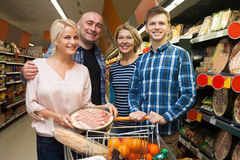 Family of four adults in the supermarket. Smiling family of four adults in the supermarket. fokus on mature woman Stock Images