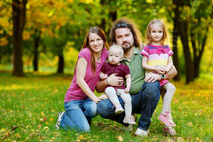 Family of four at autumn Stock Photography