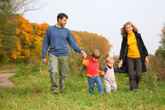 Family of four in autumn park Royalty Free Stock Images