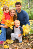 Family of four in autumn park Royalty Free Stock Image