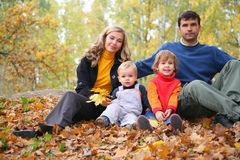 Family of four in autumn park Royalty Free Stock Photo