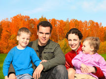 Family of four in autumnal park collage. Happy family of four in autumnal park collage stock photo