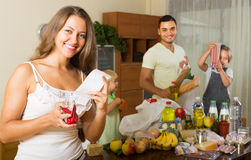 Family of four with bags of food Royalty Free Stock Photography