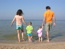 Family of four on beach Royalty Free Stock Image