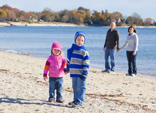 Family of four at the beach Stock Images