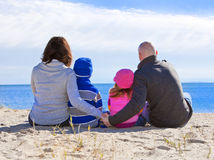 Family of four at the beach Stock Image