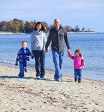 Family of four at the beach Stock Photos