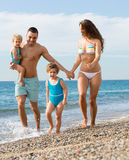 Family of four at the beach Royalty Free Stock Photography