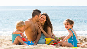 Family of four at the beach Royalty Free Stock Image