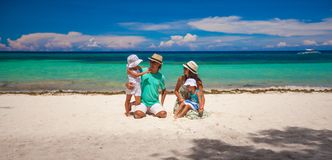 Family of four on beach vacation Stock Photography