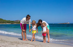 Family of four on beach vacation in Italy Royalty Free Stock Image