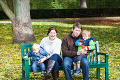 Family of four at beautiful autumn day Stock Photos