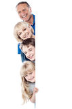 Family of four behind blank whiteboard Stock Photography