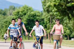 Family of four on bike tour in summer Stock Image
