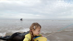 Family of four body boarding in the sea stock footage