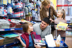 Family of four buying copy-books Stock Image