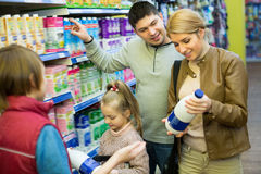 Family of four buying pasteurized milk together Stock Photos