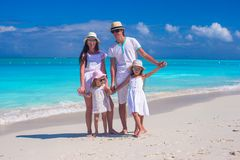 Family of four on caribbean beach summer vacation Stock Image