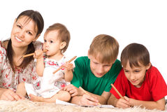 Family of a four on carpet Stock Images
