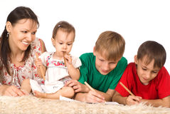 Family of a four on carpet Royalty Free Stock Images