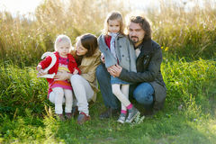 Family of four celebrating daughter's birthday. Family of four celebrating toddler daughter's second birthday stock photography