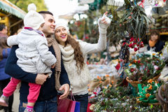 Family of four at Christmas market Stock Photos