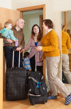 Family of four coming   home. Cheerful family of four coming to grandmother  home Royalty Free Stock Images