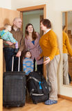 Family of four coming   home Royalty Free Stock Images