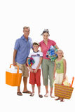 Family of four with cooler, towels and bag, smiling, portrait, cut out Royalty Free Stock Photos