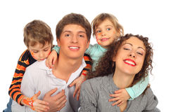 Family of four with drawings on children's faces Stock Photography