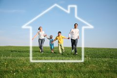 Family of four in dream house Stock Photos