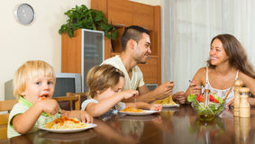Family of four eating spaghetti Stock Photography