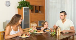 Family of four eating spaghetti Royalty Free Stock Photo