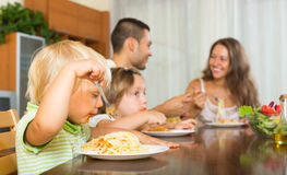 Family of four eating spaghetti Stock Images