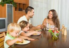Family of four eating spaghetti Royalty Free Stock Photo