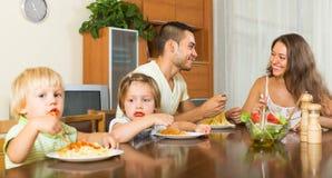 Family of four eating spaghetti Stock Photo