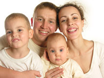 Family of four faces isolated 2. Family of four faces with child and baby isolated 2 stock image