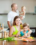 Family of four fish salmon cooking at home kitchen Royalty Free Stock Images