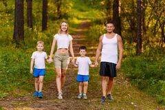 A family of four in the forest stock image